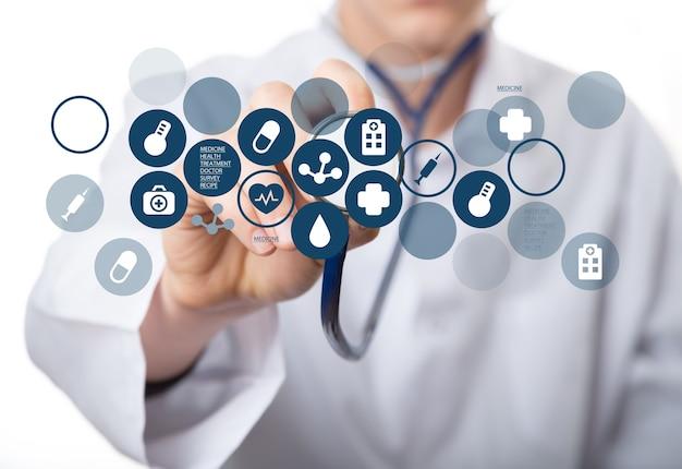 Ikony medyczne i młody lekarz ze stetoskopem