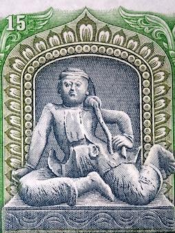 Ilustracja alchemika z birmańskich pieniędzy