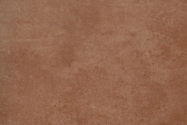 Ilustracja pomarańczowej powierzchni z zadrapaniami i rdzą