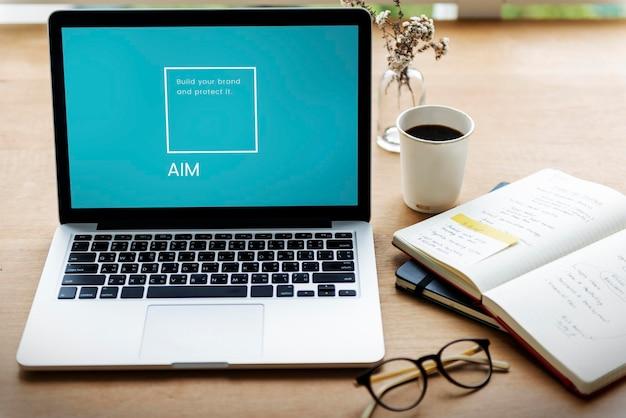 Ilustracja przedstawiająca znak firmowy marki tożsamości na laptopie