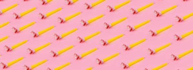 Imprezowe gwizdki na różowym tle