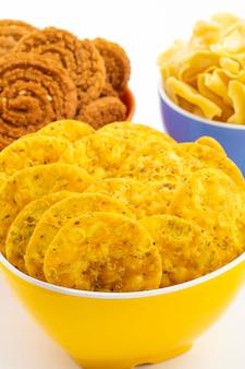 Indian street snack masala khari papdi with besan papri lub chakli