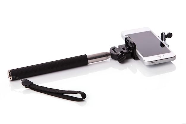 Inteligentny telefon i selfie stick