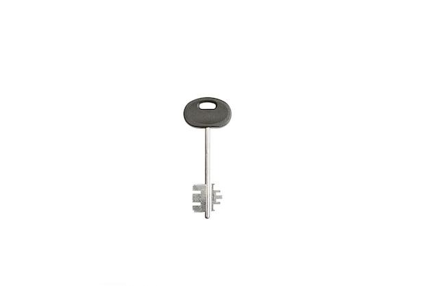 Izolowanie metalowego klucza na białym tle.