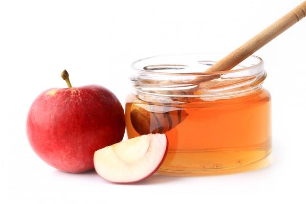 Jabłko i miód na białym tle