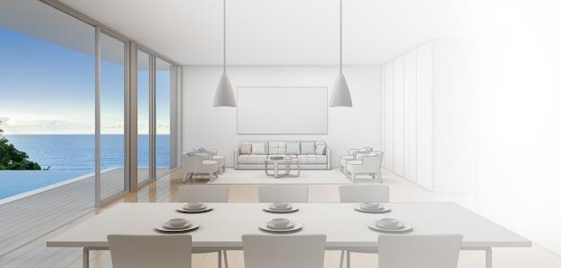 Jadalnia i salon luksusowego domu na plaży z basenem z widokiem na morze.