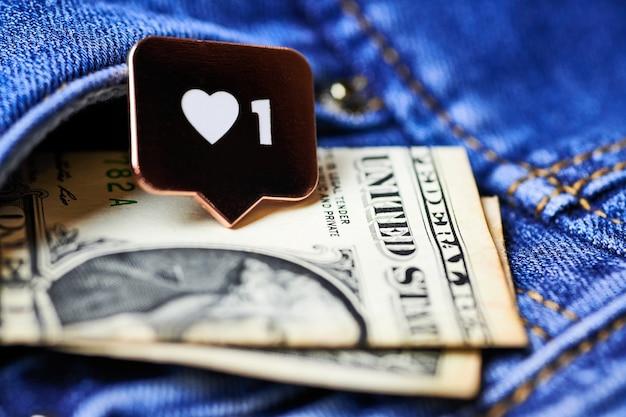 Jak symbol serca i dolar w kieszeni dżinsów. jak przycisk znaku, symbol z sercem i jedną cyfrą. marketing sieciowy w mediach społecznościowych.