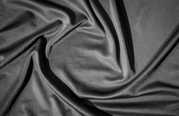 Jako tło można użyć czarnej tekstury tkaniny