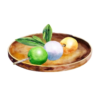 Japoński dango na talerzu z zielonymi liśćmi na białym tle