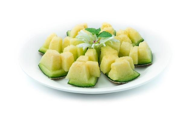 Japoński melon cięcie słodki smak owocowy deser serwowany na stole, impreza tak pyszna i soczysta, łatwa w daniu zdrowo udekoruj rzeźbioną japońską cebulą i szczypiorkiem