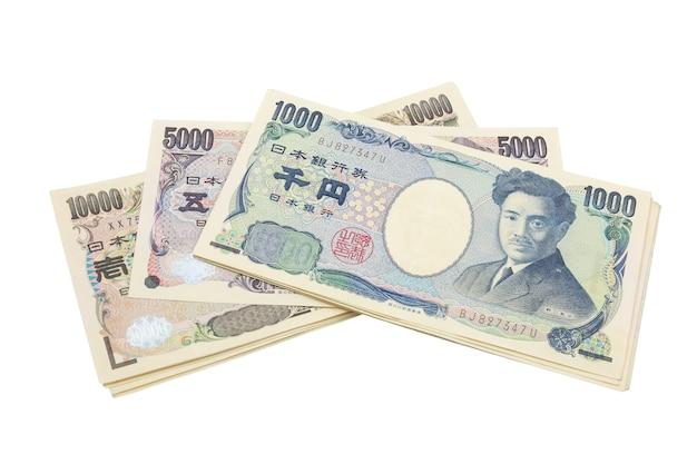 Japońskie notatki jena. waluta japonia na białym tle