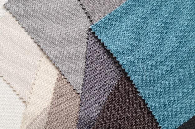 Jasna kolekcja próbek tekstylnych z brązu. tekstura tkanina tło.