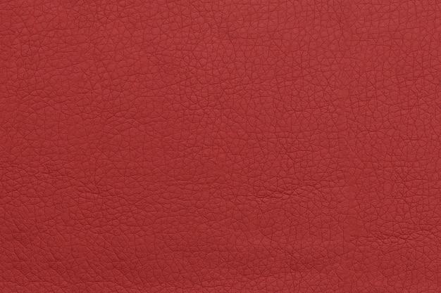 Jasne czerwone skórzane tło. powierzchnia tekstur z wzorem.