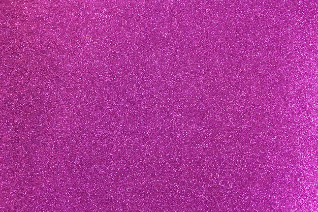 Jasne fioletowe błyszczące tło z błyszczy.