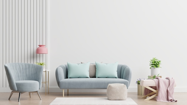 Jasne i przytulne nowoczesne wnętrze salonu posiada sofę, fotel oraz lampkę z białą ścianą