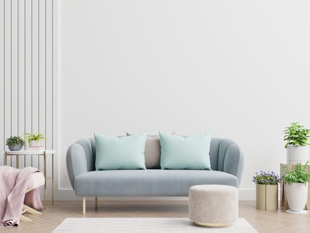 Jasne i przytulne nowoczesne wnętrze salonu posiada sofę i lampkę z białą ścianą
