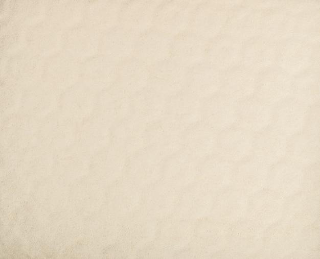 Jasnobeżowy wzór tekstury piasku morskiego
