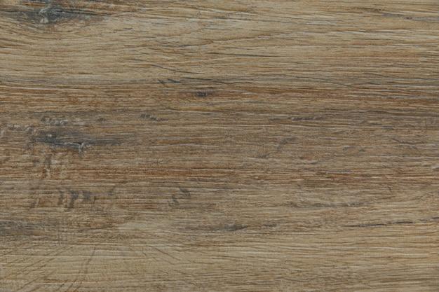 Jasnobrązowa drewniana powierzchnia tła o rozcieńczonym odcieniu