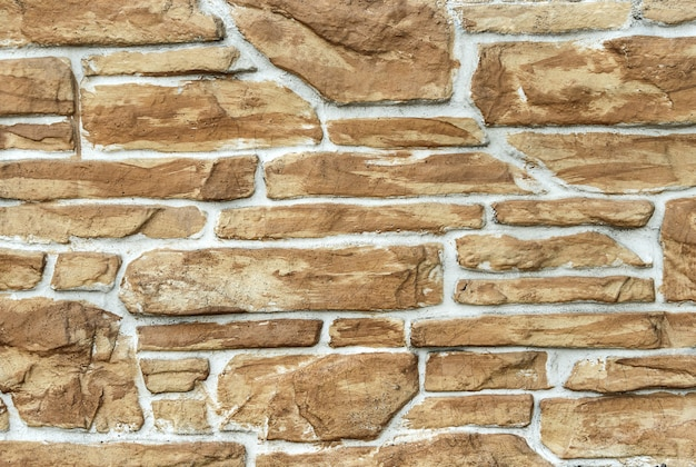 Jasnobrązowe tło murowane z kamienia