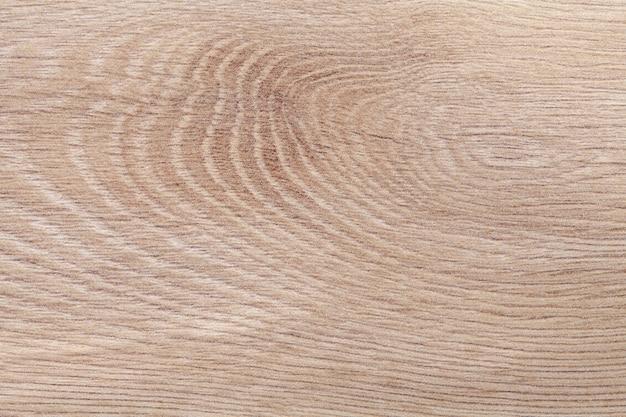Jasnobrązowo-beżowy odrapany laminat vintage. drewniane tekstury. struktura starego drewna
