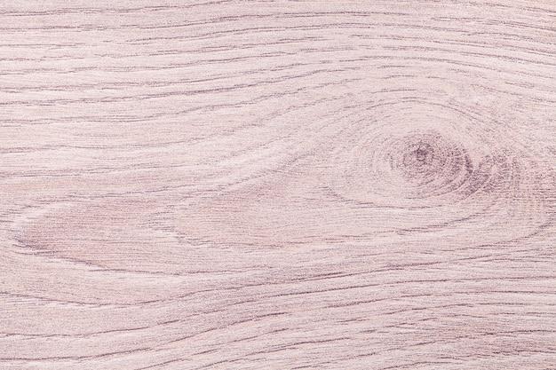 Jasnobrązowo-beżowy odrapany laminat vintage. drewniane tekstury. struktura starego różowego drewna