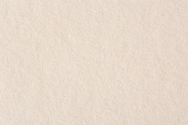 Jasnobrązowy papier w tle. zdjęcie w wysokiej rozdzielczości.