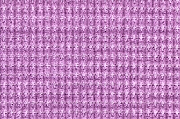 Jasnofioletowe tło z miękkiego miękkiego materiału z bliska. tekstura tekstylne makro