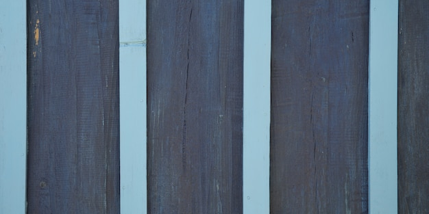 Jasnoniebieskie i granatowe paski drewniane deski tekstura drewniane szare tło