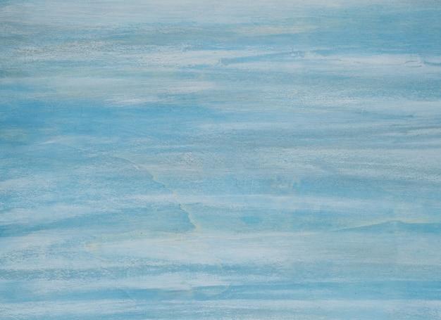 Jasnoniebiesko-biała ściana z fakturą. obraz w wysokiej rozdzielczości z miejsca kopiowania