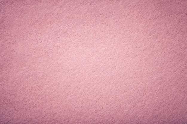 Jasnoróżowy matowy zamszowy zbliżenie tkaniny.