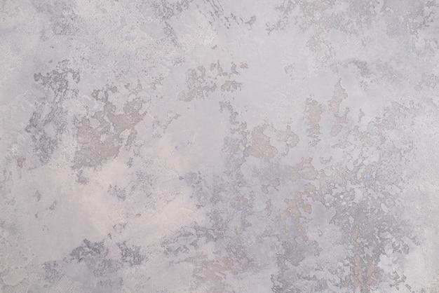 Jasnoszara tekstura dekoracyjnego tynku weneckiego jako tła.