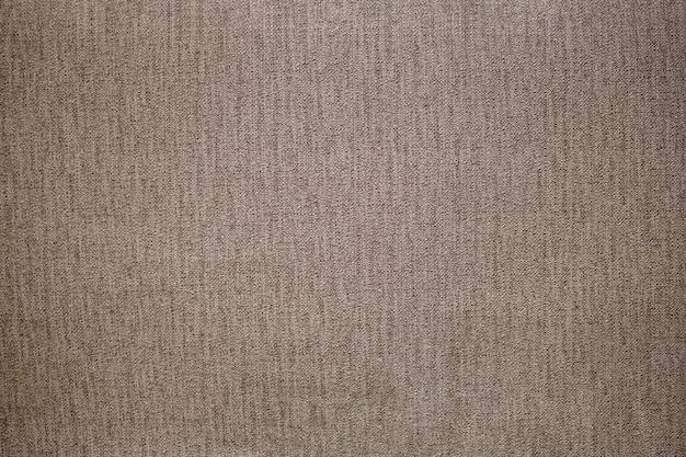 Jasnoszara wełniana lub tweedowa tkanina na tło grunge