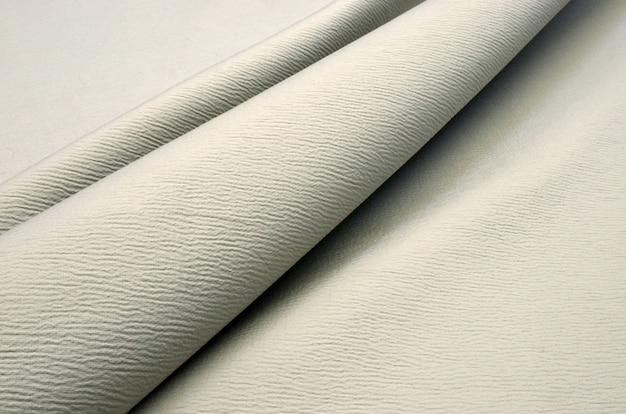 Jasnoszary materiał bawełniany
