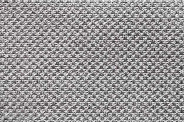 Jasnoszary materiał w kratkę wzór, zbliżenie. struktura makra tkaniny.