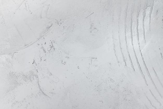 Jasnoszary stiuk. grunge tekstura z abstrakcjonistycznymi okręgami.