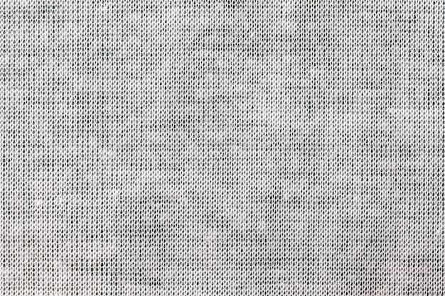 Jasnoszary, tło z materiału tekstylnego. tkanina o naturalnej fakturze. zasłona.
