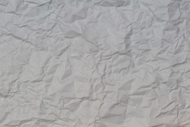 Jasnoszary zmięty pomarszczony papier tekstura tło