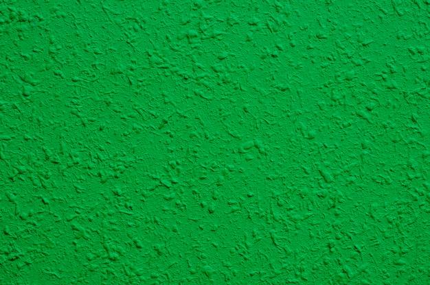 Jasnozielona betonowa ściana do wnętrz, tapety artystycznej lub artystycznej tekstury tła