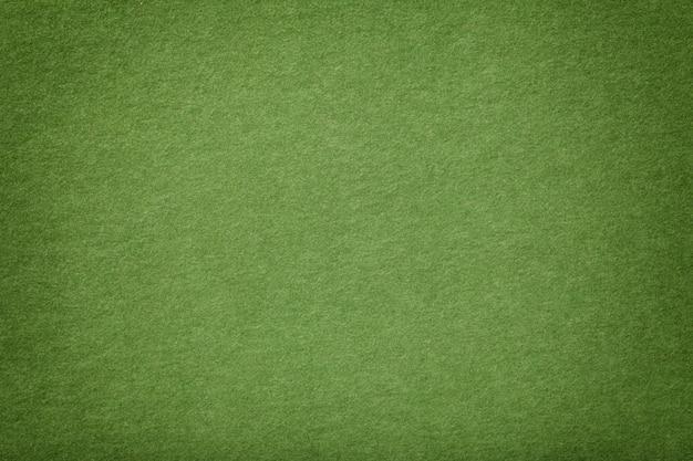 Jasnozielona matowa zamszowa tkanina o aksamitnej fakturze,