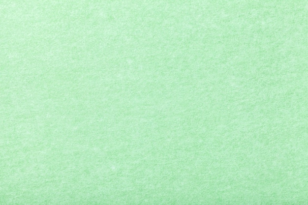 Jasnozielony matowy zamszowy materiał. aksamitna faktura filcu.