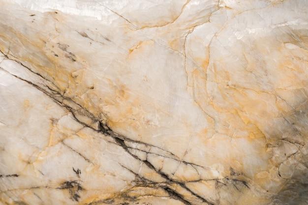 Jasnożółta i szara marmurowa płytka z naturalnym wzorem i fakturą