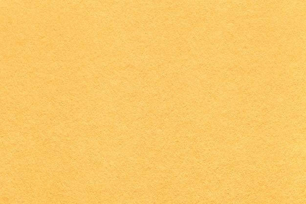 Jasnożółty papierowy tekstury tło