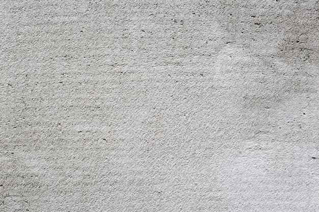 Jasny i ciemny szary podzielony na części betonowe tekstury tła uszkodzony