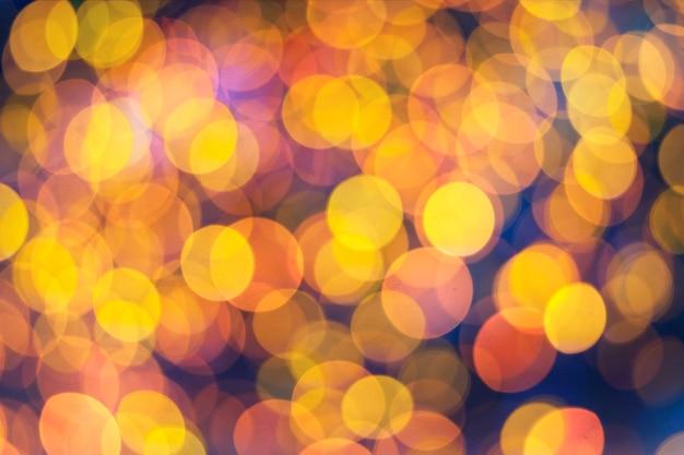 Jasny kolorowy żółty i złoty noc bokeh.