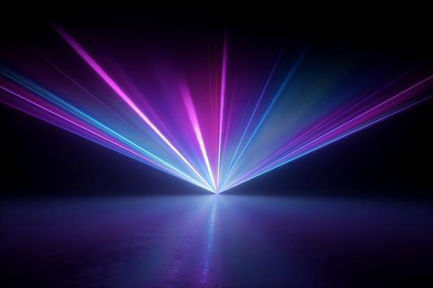 Jasny projektor świecący na ciemnej, pustej scenie.