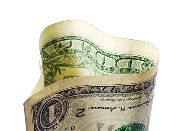 Jeden dolar w formie serca na białym tle