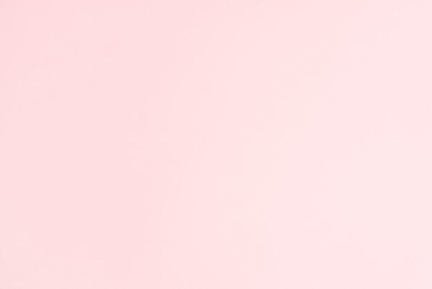 Jednolite, jasnoróżowe, płaskie tło. widok z góry, płaski układ. poziomy, szeroki ekran