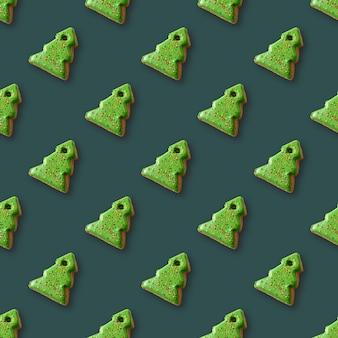 Jednolity wzór ciasteczek jako choinki na zielono