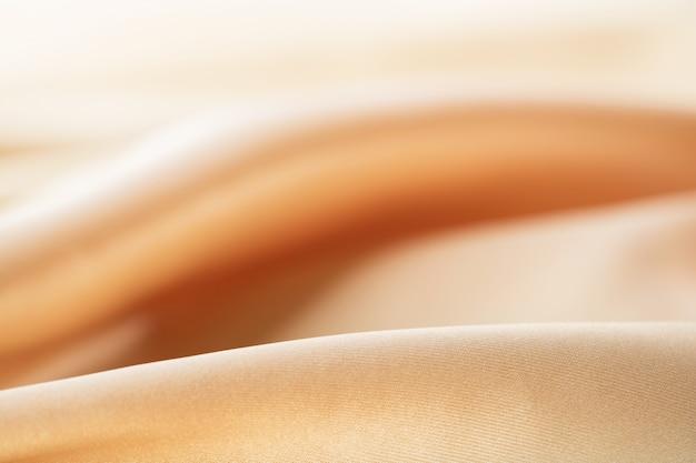 Jedwabna tekstura, bakground, luksusowa satyna do abstrakcji, designu i tapety, miękka i rozmyta, gładka