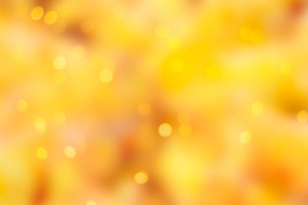 Jesienne jasne, żółte abstrakcyjne rozmyte tło z bokeh